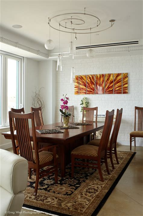 custom track lighting accents the dining space