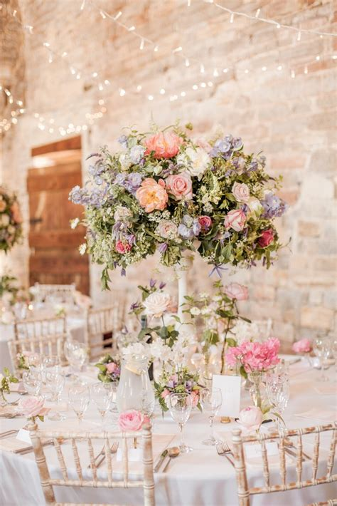 wedding table flower decorations uk almonry barn wedding with pink colour scheme
