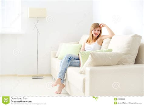 sitting on sofa girl sitting on sofa stock photos image 29868453