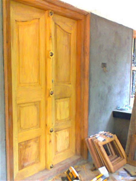 kerala style carpenter works  designs main entrance
