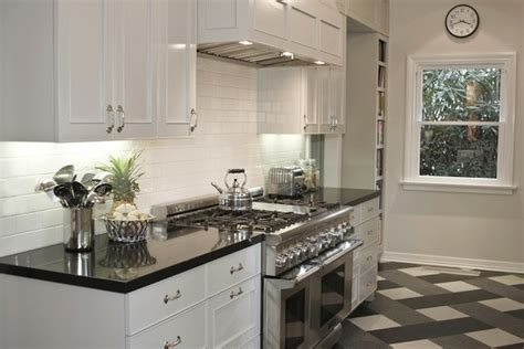 white kitchen cabinets with black countertops polished black countertops transitional kitchen