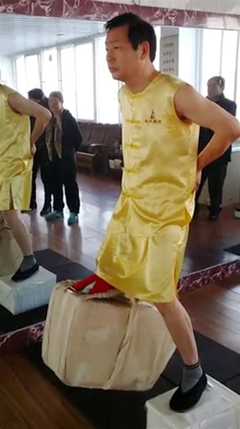 swinging testicles chinese weightlifter raises 80kg of bricks with testicles