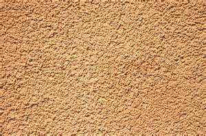 Stucco Texture Paint - on a photo a structure a stone wall of sand color stock photo colourbox