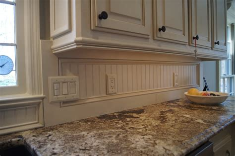 light rail molding for kitchen cabinets check out the beadboard backsplash also light rail