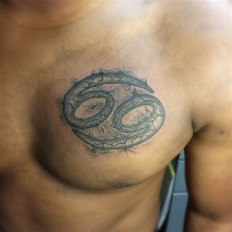 grey ink zodiac cancer on chest for