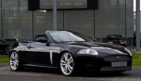 black convertible cars black cabriolet jaguar luxury convertible car on road