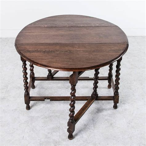 oak console with barley twist early 20th century solid oak gateleg barley twist dining table or console at 1stdibs