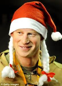 Royal bedroom prince harry dresses up in a santa hat to amuse his