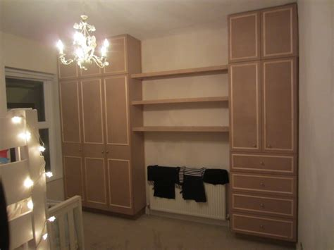 bedroom wardrobe built around chimney breast diy wardrobes information centre in addition to building wardrobes within the recesses of the chimney breast shelves