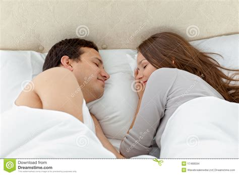 couple sleeping together serene couple sleeping together on their bed stock images
