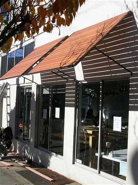 wood awning wood slat awnings awning ideas pinterest