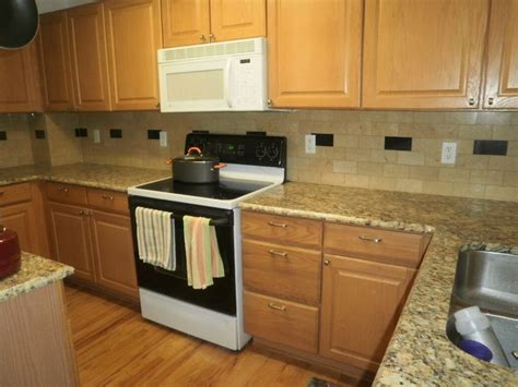 granite countertops with light cabinets giallo ornamental granite with maple cabinets giallo