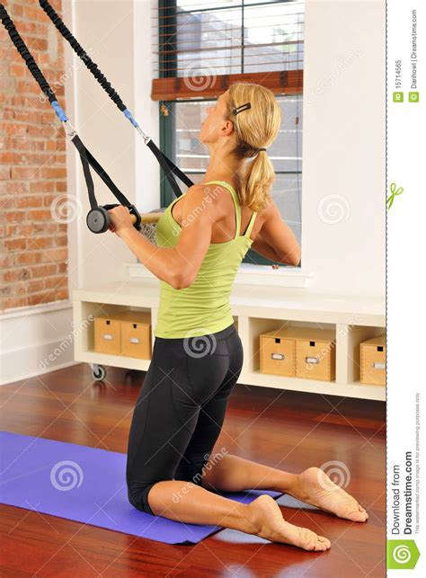 pilates stretch with bar at home royalty free stock photo