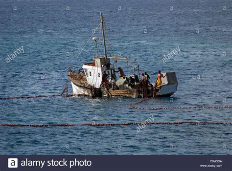 boat seine net hauling net fishing boat stock photos hauling net