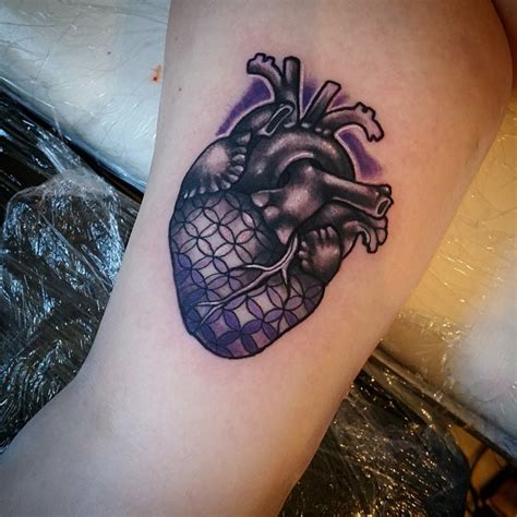 heartbeat tattoo on bicep 45 spectacular inner bicep tattoo ideas for men