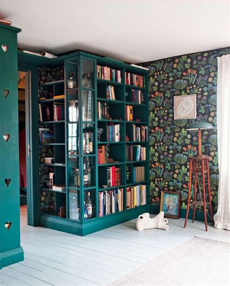 library colors from the right bank josef frank wallpaper with books