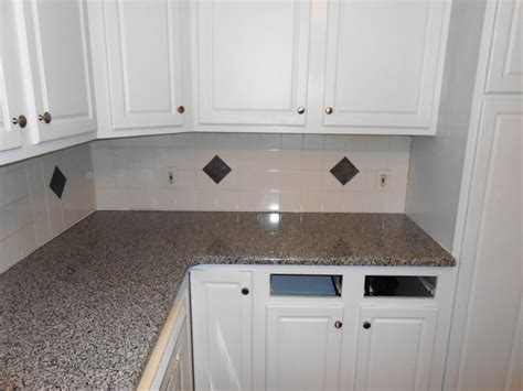 new caledonia granite white cabinets caledonia granite for white cabinets traditional