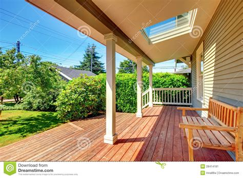 Covered Porch House Plans by Large Covered Porch With Skylight And Wood Bench And Floor