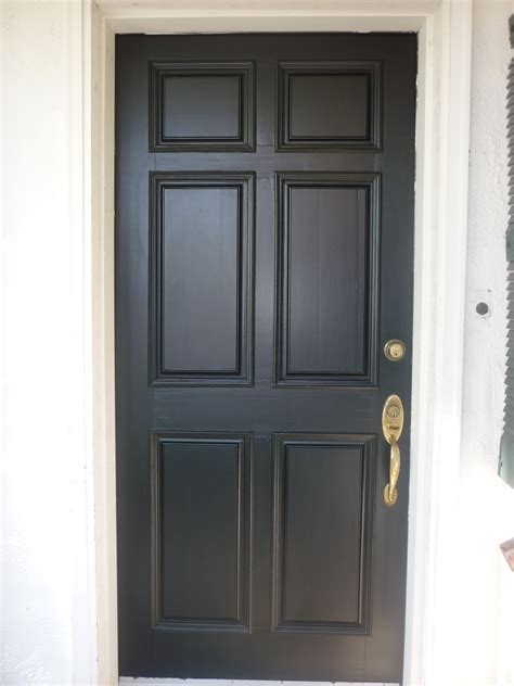 door front doors there s just something about a black front door hardwood floors and black front doors