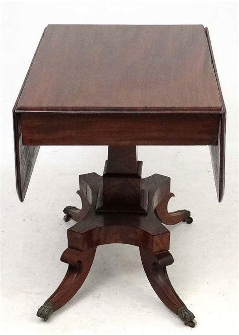 a 19thc mahogany pedestal sofa table 36 wide x 44 exten