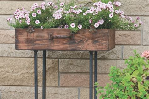 Planter With Legs by How To Make An Upcycled Suitcase Planter With Gas Pipe