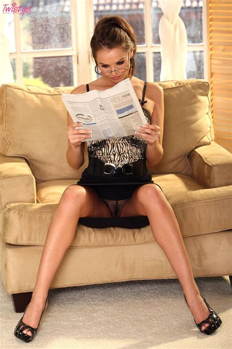 tori black reading the newspaper in a little tiny outfit
