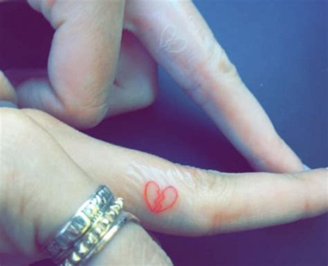 heart tattoo on finger celebrity together forever love sealed with ink heart