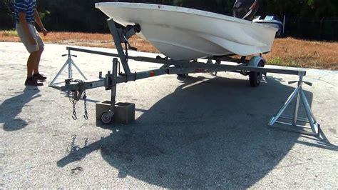 lifting pontoon boat off trailer scaffoldmart s boat lift trailer removal system youtube