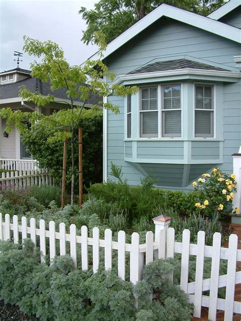 english cottage style with picket fence