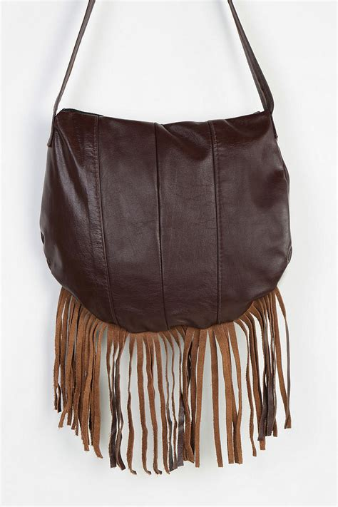 leather fringe bags outfitters renewal leather fringe crossbody bag in brown lyst