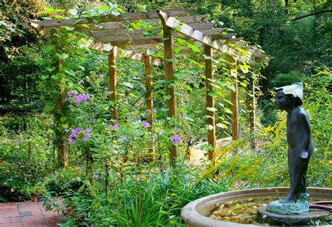 25 design ideas for an arch arbor or trellis garden pics and tips