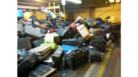 baggage laid out at airline luggage counter after flight united recalls 40 laid off r agents at dia