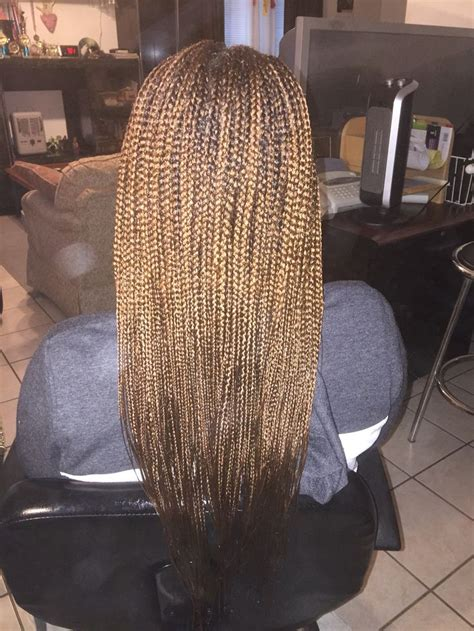 saved hair in the back and box braids in the front box braids with 30 mid back length small small medium