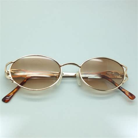 pretty gold oval frame sunglasses tinted bifocal reading