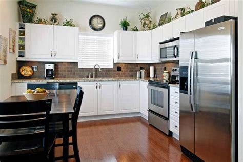 greenery above kitchen cabinets greenery above kitchen cabinets ideas in l shaped kitchen