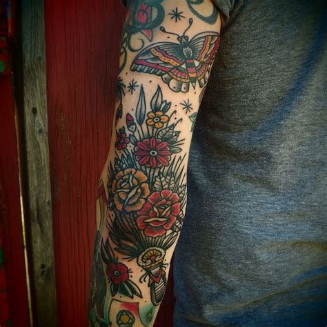 american traditional sleeve tattoo 17 best ideas about traditional flower tattoos on
