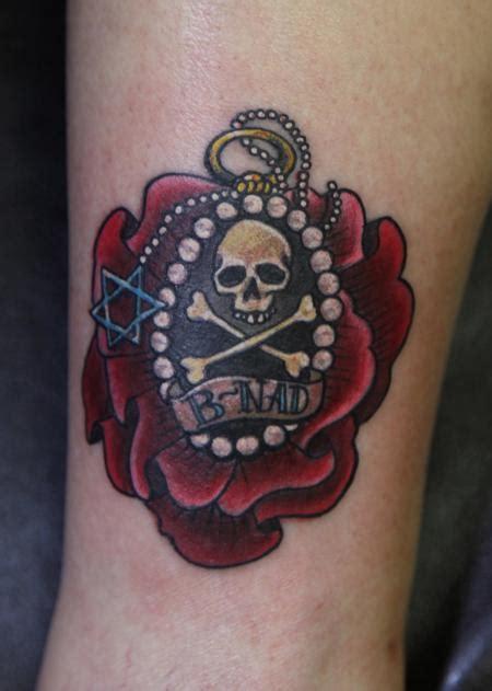 skull and cross bones tattoo junkies studio tattoos mario rosenau