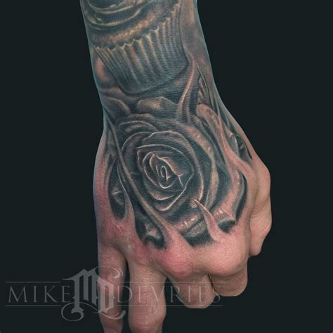 black rose hand tattoo black and grey on right by mike devries