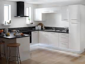 kitchen white galley kitchen with black appliances