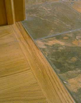 historic use of thresh on floor installing hardwood against tile transition without moldings