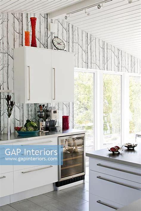 gap interiors modern kitchen  tree wallpaper feature