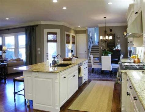 kitchen island with sink and dishwasher and seating home