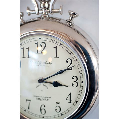 silver pocket wall clock by the orchard notonthehighstreet