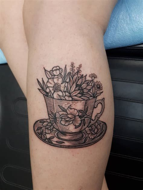 tea cup tattoo teacup and flowers by at sanctuary tattoos