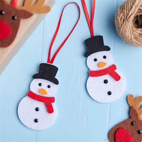 set of two felt snowman decorations by the home