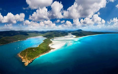 green wallpaper australia whitsunday island australia sea sky and white clouds green