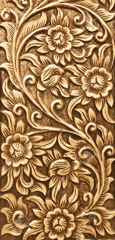wood engraving pattern pattern of flower carved on wood background stock photo