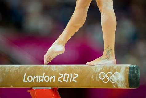 gymnastics tattoos of italy performed on the balance beam