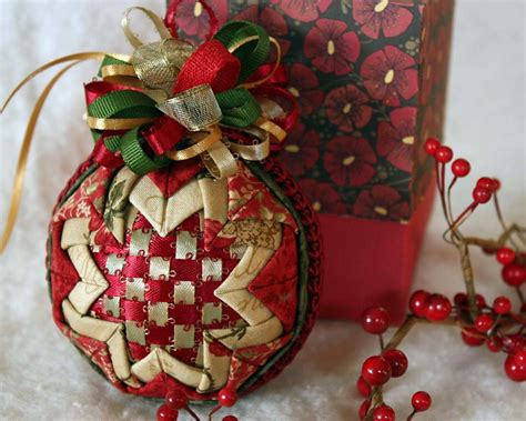 christmas bulbs demcoration with fabric woven ribbon and folded fabric ornament in