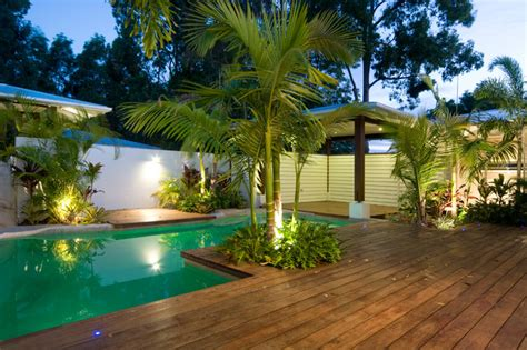 tropical backyards with a pool home designer summit house tropical pool other metro by skale